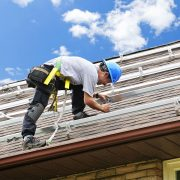 Man installing Solar Rails on Residential house